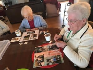 two assisted living residents doing activity together