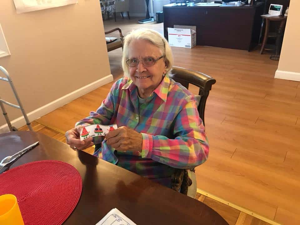 assisted living resident doing a craft